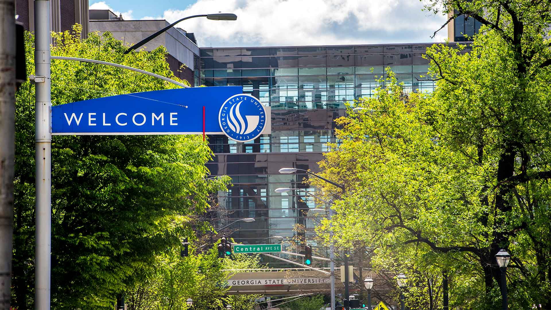 "Sign that says ""Welcome"" with Georgia State branding above street"